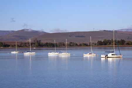 howick: yachts at early morning on the midmar dam Stock Photo