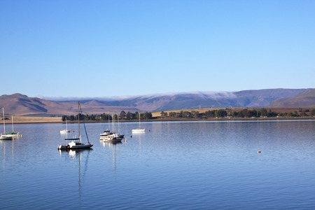 howick: yachts moored off the shore at midmar dam Stock Photo