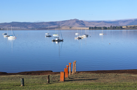 howick: markers leading into the water at midmar dam Stock Photo