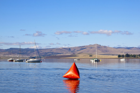 howick: inflated red buoy as marker on midmar dam