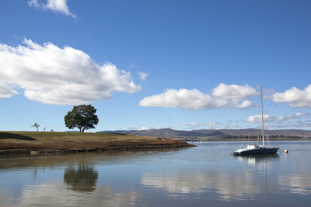 howick: single yacht moored off the banks of midmar dam