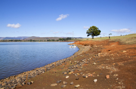 howick: exposed bank showing drop in level of midmar dam