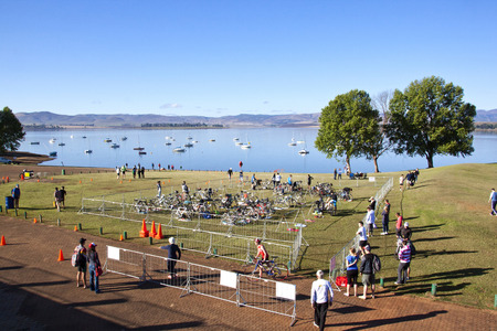 howick: HOWICK, KWAZULU NATAL, SOUTH AFRICA - OCTOBER 19, 2014: Many unknown participants and spectators gather for the On LIne Tri Series Race 1 triathlon at Midmar Dam in the Natal midlands