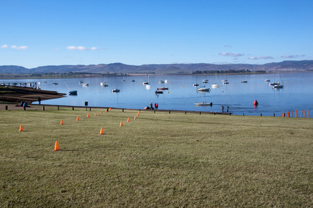 howick: HOWICK, KWAZULU NATAL, SOUTH AFRICA - OCTOBER 19, 2014: Early Morning organisers set out the coarse for On LIne Tri Series Race 1 triathlon at Midmar Dam in the Natal midlands