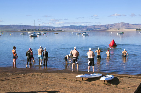 howick: HOWICK, KWAZULU NATAL, SOUTH AFRICA - OCTOBER 19, 2014: Many unknown partisipants gather at starting point for the On LIne Tri Series Race 1 triathlon at Midmar Dam in the Natal midlands