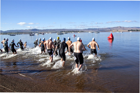 HOWICK, KWAZULU NATAL, SOUTH AFRICA - OCTOBER 19, 2014: Many unknown participants start the On LIne Tri Series Race 1 triathlon at Midmar Dam in the Natal midlands Editorial