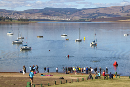 howick: HOWICK, KWAZULU NATAL, SOUTH AFRICA - OCTOBER 19, 2014: Many unknown participants and spectators gather for the start of the On LIne Tri Series Race 1 triathlon at Midmar Dam in the Natal midlands