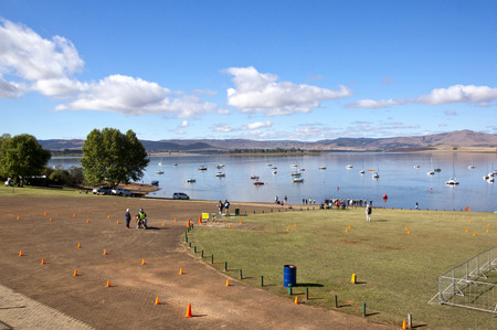 howick: HOWICK, KWAZULU NATAL, SOUTH AFRICA - OCTOBER 19, 2014: Many early unknown participants and spectators gather for the On LIne Tri Series Race 1 triathlon at Midmar Dam in the Natal midlands Editorial