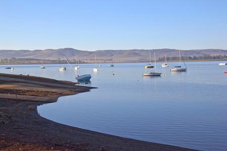 howick: Early morning view of boat slipway on Midmar dam against Yachts anchored in water at Howick, Kwa-Zulu Natal, South Africa Editorial