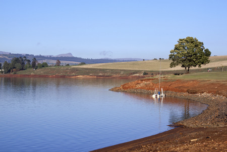 howick: Landscape view of sunken yacht in the shallows of Midmar Dam in the Midlands of Natal in South Africa
