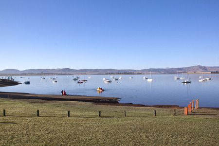 howick: View from grassy bank of yachts anchored in Midmar dam in the Midlands of Kwa-Zulu Natal in South Africa