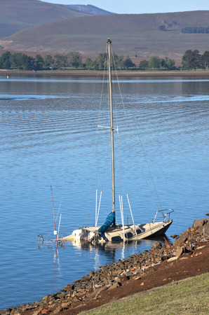 howick: Sunken aboandoned yacht in the shallows of Midmar dam in the Natal Midlands in South Africa Editorial