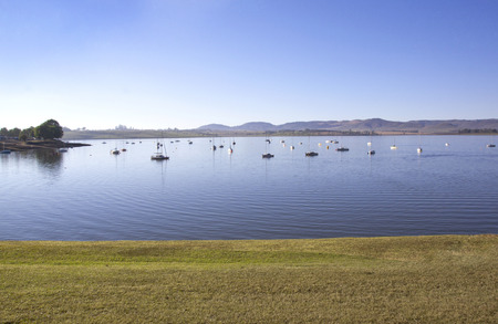 howick: View from grass verge of yachts moored on the midmar dam in the natal midlands, Howick, KwaZulu-Natal South Africa Editorial