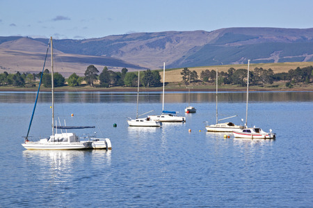 howick: Landscape view of  mountains overlooking idle yachts anchored in Midmar dam in the  Midlands of Natal in South Africa