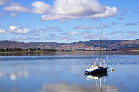 howick: Landscape view of yacht in Midmar dam and distant township in the Midlands of Kwa Zulu Natal in Howick, South Africa Editorial