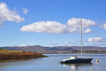 kwazulu natal: Lone yacht anchored off the banks of Midmar dam in the Midlands of KwaZulu Natal in South Africa