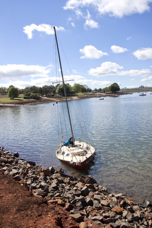 howick: Sunken yacht on the banks of the Midmar dam in Howick,  Kwa Zulu Natal, South Africa
