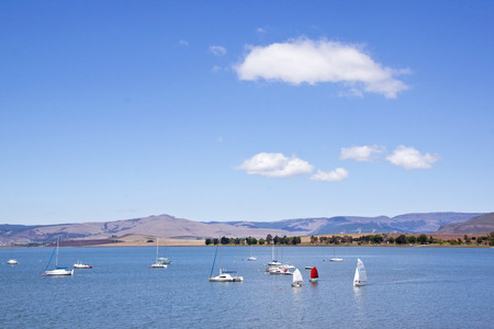 howick: Over view of yachts in dam and cloudy blue sky landscape at Midmar Dam in the Midlands of KwaZulu Natal in South Africa