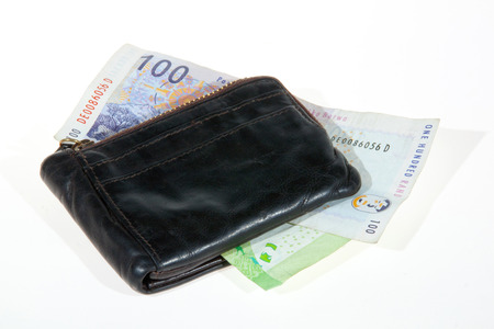 south african bank notes enclosed by leather wallet Banco de Imagens