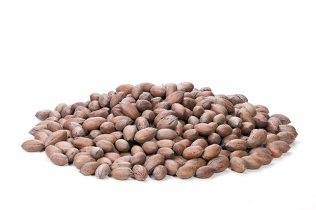 whole pecans: pile of unshelled rich brown pecan nuts
