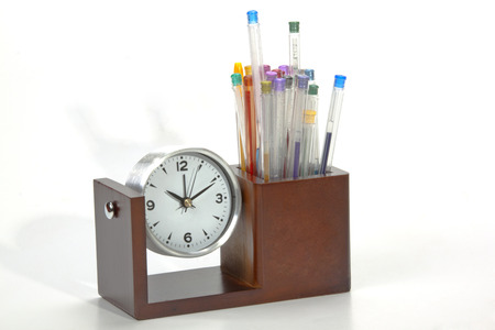 analogue: battery operated analogue clock with colorful pens in holder