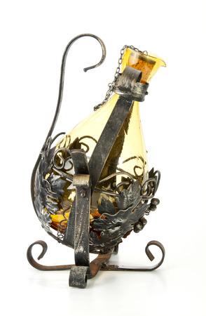 glass wine decanter in ornate metal swivel frame