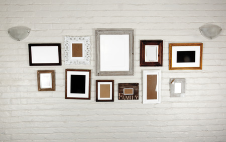 bagged: empty frames and lamps on white bagged wall