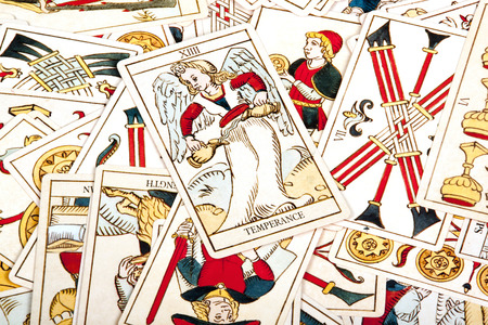 tarot: large collection of scattered colored tarot cards