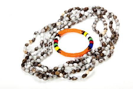 beaded: zulu beaded necklace with bright orange armband Stock Photo