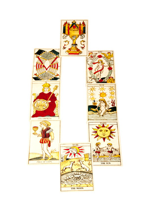 parapsychology: tarot cards set out in the mirror spread