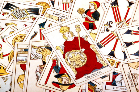 large scattered collection of colorful tarot cards photo