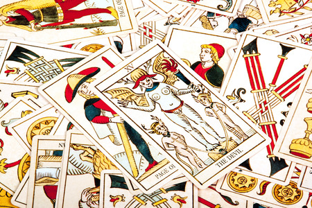 parapsychology: bright colorful collection of scattered tarot cards