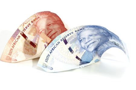 nelson mandela: Two Semi Rolled South Africa Bank Notes showing the face of Nelson Mandela