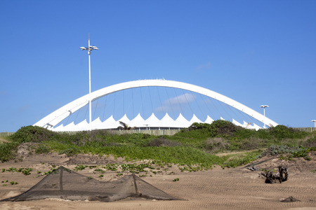 stadium  durban: DURBAN, SOUTH AFRICA - DECEMBER 4, 2014:  Viewing Moses Mabhida stadium from beach in Durban, South Africa