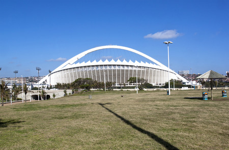 recreational area: DURBAN, SOUTH AFRICA - DECEMBER 4, 2014:  Viewing Moses Mabhida stadium from grass recreational area on Beach front  in Durban, South Africa