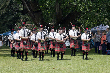 kwazulu natal: Richmond, KwaZulu Natal, South Africa - December 7, 2014: Pietermaritzburg Scottish Caledonian pipe band perform at Natal Vintage Tractor and Machinary Club at Baynesfield Estate in Richmond, KwaZulu-Natal, South Africa