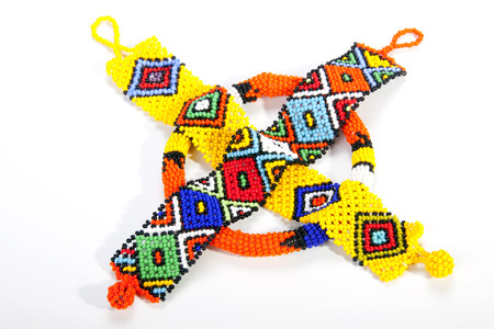 wristbands: two zulu beaded wristbands and orange armband