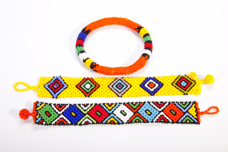 zulu: two brightly colored zulu wristbands with beaded armband