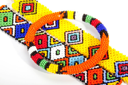 wristbands: circular beaded zulu armband atop two wristbands