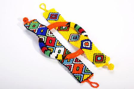 zulu: three pieces of brightly colored beaded zulu jewelry Stock Photo