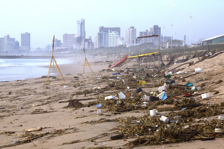 spring tide: DURBAN, SOUTH AFRICA - JANUARY 6, 2015:  Debris and pollution washed up on beach during spring tide in Durban, South Africa Editorial