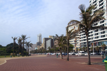 beach front: DURBAN, SOUTH AFRICA - JANUARY 6, 2015:  Early morning empty promenade and buildings on beach front on Golden Mile beach front in Durban, South Afric