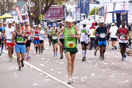 spectators: DURBAN, SOUTH AFRICA - JUNE 1, 2014: Spectators and Many runners competing in the long distance Comrades Marathon between Pietermaritzburg and Durban in South Africa. Editorial