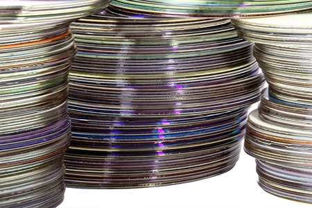 optical disk: three piles of colored shiny compact discs