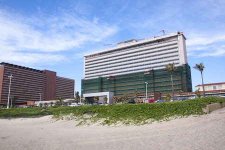 refurbished: DURBAN, SOUTH AFRICA - MARCH 15, 2015: Beach view of partially refurbished Addington Hospital in Durban, South Africa Editorial