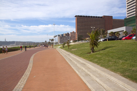 beachfront: DURBAN; SOUTH AFRICA - MARCH 15; 2015: Many unknown people walk along promenade on Durbans Golden Mile beachfront