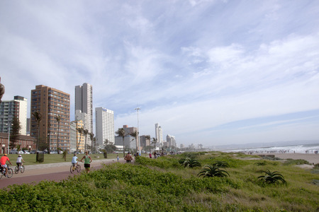 beachfront: DURBAN, SOUTH AFRICA - MARCH 15, 2015: Many unknown pedestrians and cyclist on promenade on Goldem Mile beachfront in Durban, South Africa Editorial