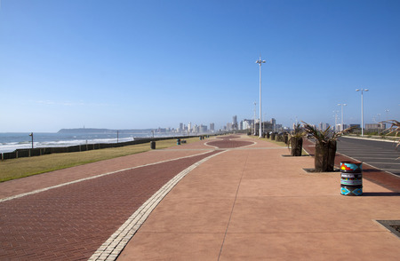 empty paved walkway promenade with hotels in distance at durbans golden mile
