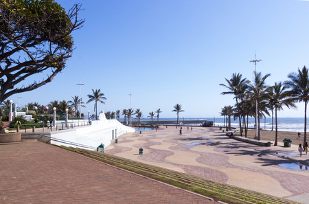 beachfront: DURBAN, SOUTH AFRICA - DECEMBER 4, 2014: Many unknown people on promenade on beachfront in Durban, South Africa