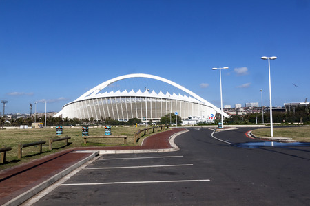 stadium  durban: DURBAN, SOUTH - AFRICA, DECEMBER 4, 2014: Empty parking lot in front of Moses Mabhida stadium Durban, South Africa